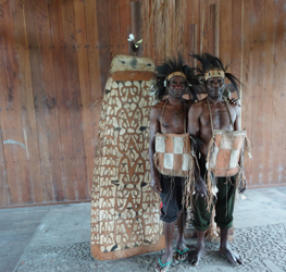 Mbes and Serambi, from the village of Er, ask to have their photo taken dressed up as 'people from Jakapis' while visiting that village, having found items of self-decoration stored in the local Church (Tom Powell Davies, 2016)