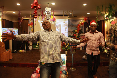 'Praise my God!' - a Nigerian man in an underground African Pentecostal Church, Guangzhou, China (Yu Qiu, 2014)