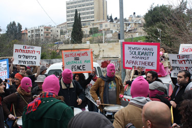 Activists in a drum circle wear pink face masks (Fiona Wright, 2014)