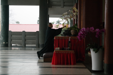 Novice nun making an incense offering before the main hall in the monastery in Chiayi, Taiwan (Nancy Chu, 2016)